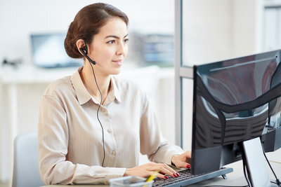rsz_female-secretary-wearing-headset-in-office-j52h4ap